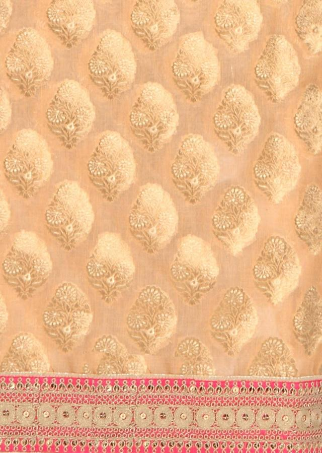 Peach unstitched suit with embroidered hem line only on Kalki