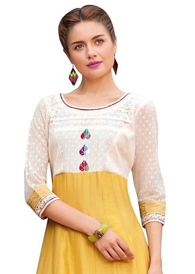 Yellow anarkali suit adorn in resham and applique work