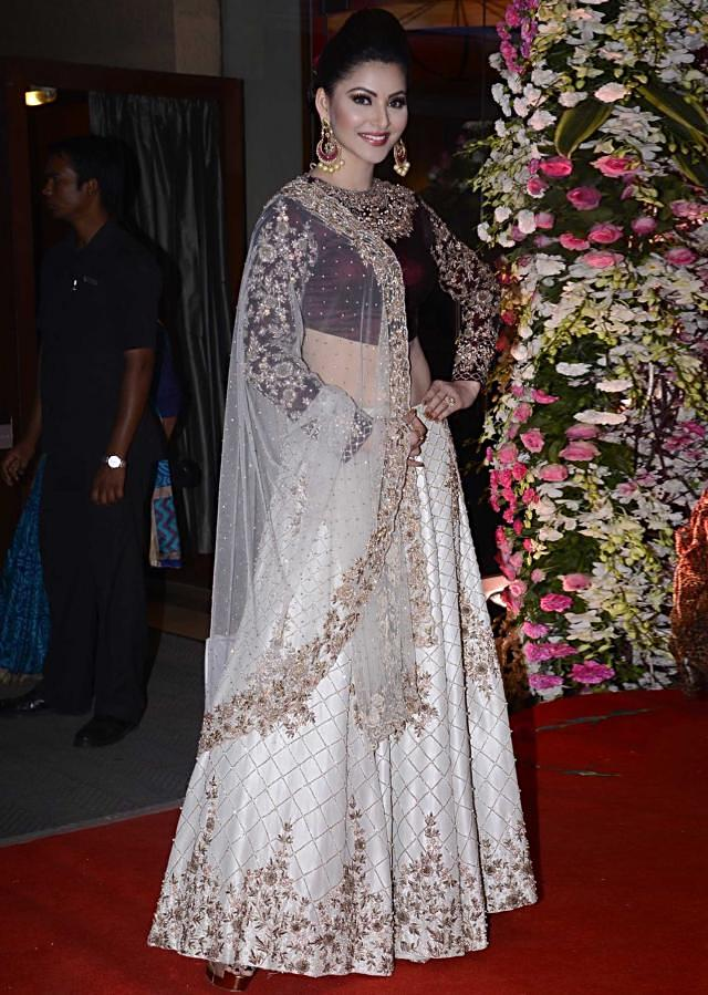 Urvashi Rautela in Kalki mint lehenga with maroon velvet blouse