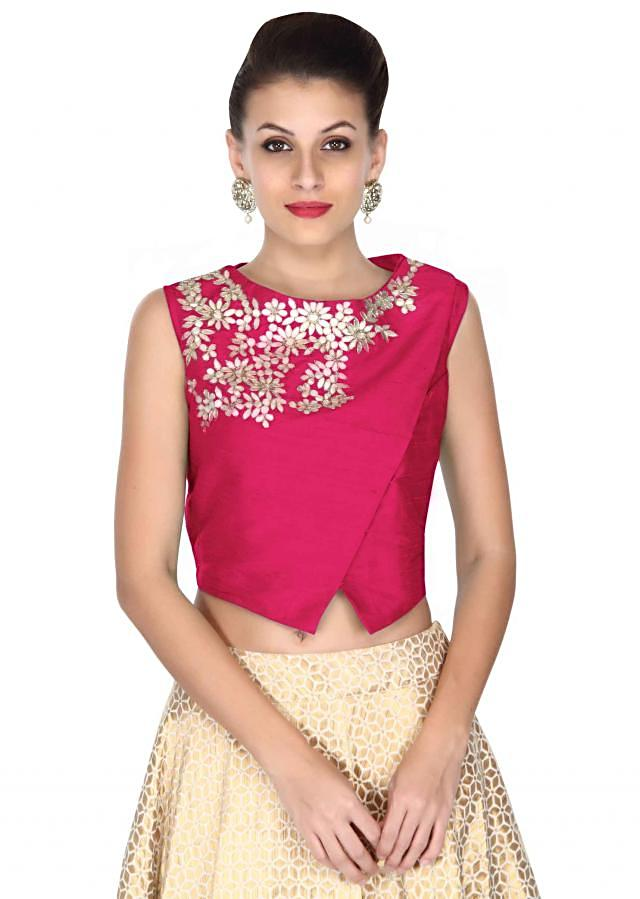 Beige lehenga with Hot pink blouse in zari embroidery only on Kalki
