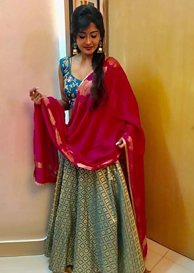 Kanchi Singh in Teal and gold brocade skirt with grey embroidered blouse only on Kalki