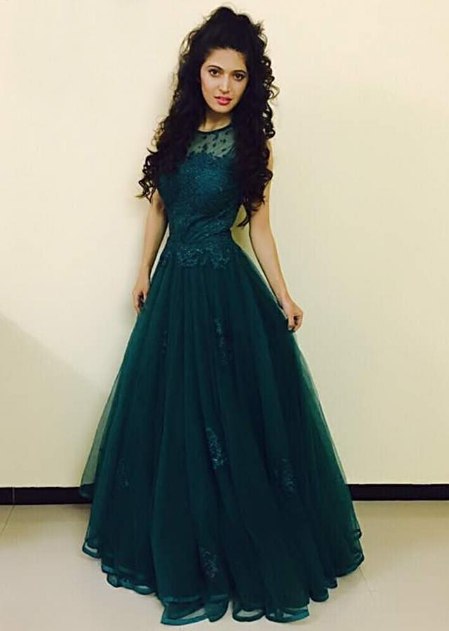 Charlie Chauhan in Kalki teal blue net gown studded with stones