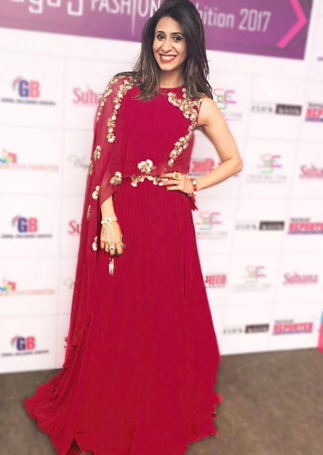 Kishwer Merchant in Kalki cardinal red gown with fancy embroidered cape