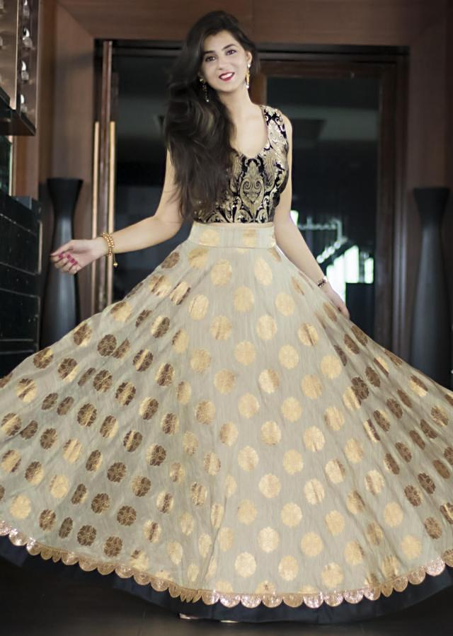 Cream skirt in polka dots with black brocade blouse only on Kalki