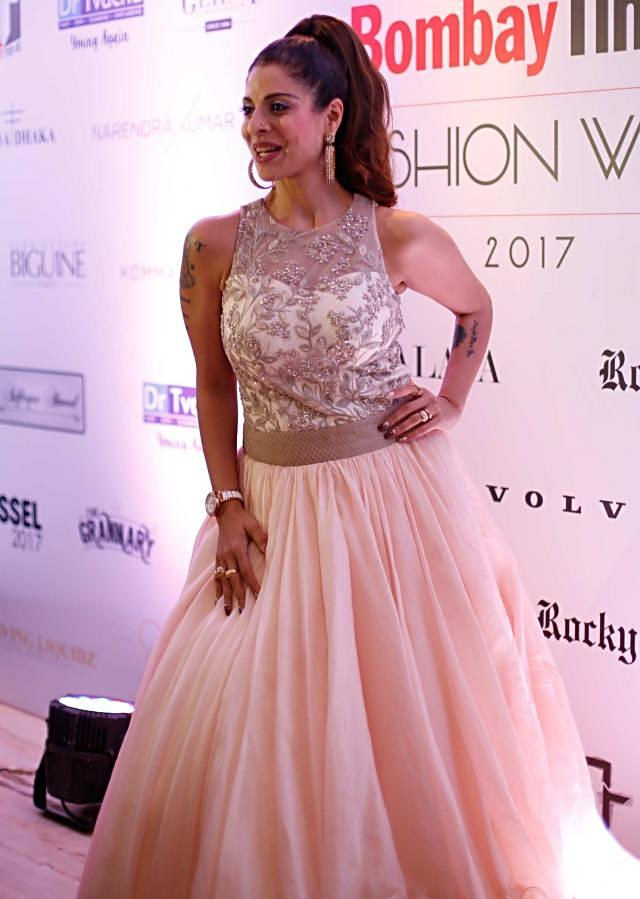 Pearl Peach Fancy Net and Organza Satin Gown Adorned with Embroidery and Highlighted Work only on Kalki
