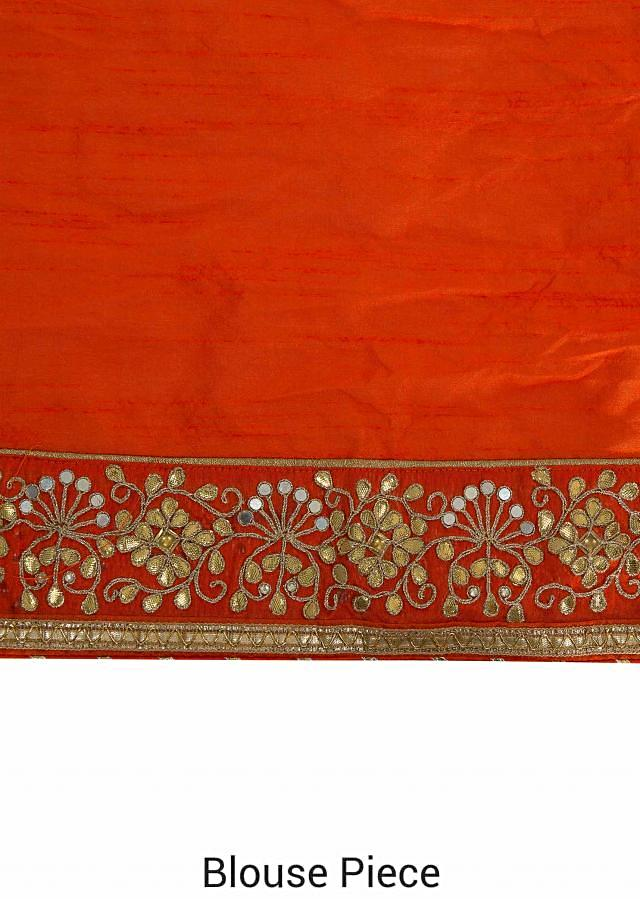 Half and half bandhani saree in orange , red and peach with gotta patch border only on Kalki