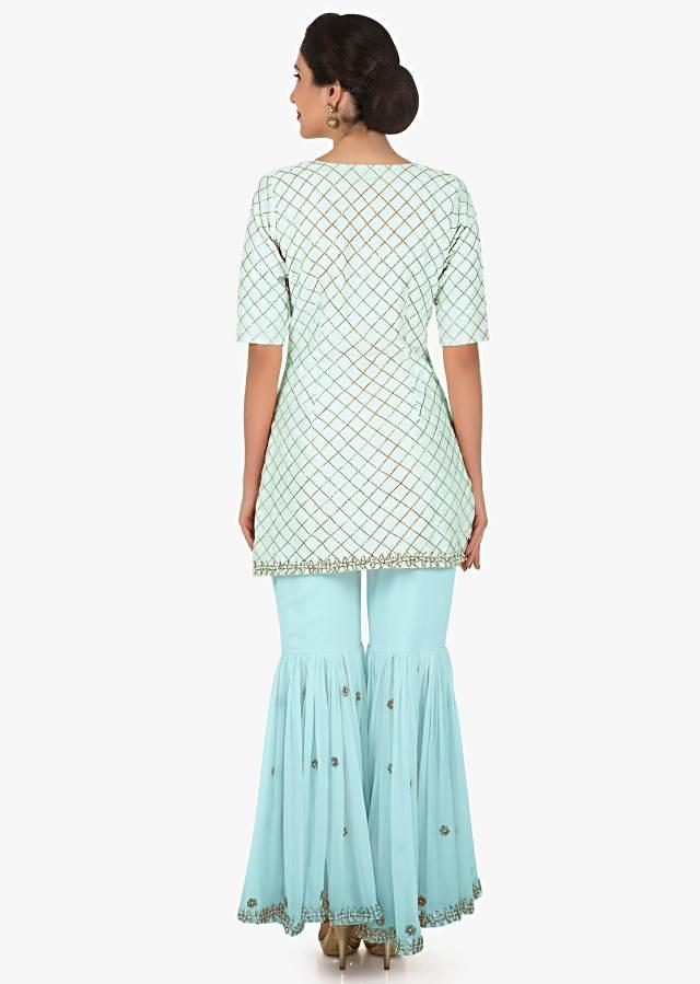Sky blue sharara suit beautified in zari embroidered work only on Kalki