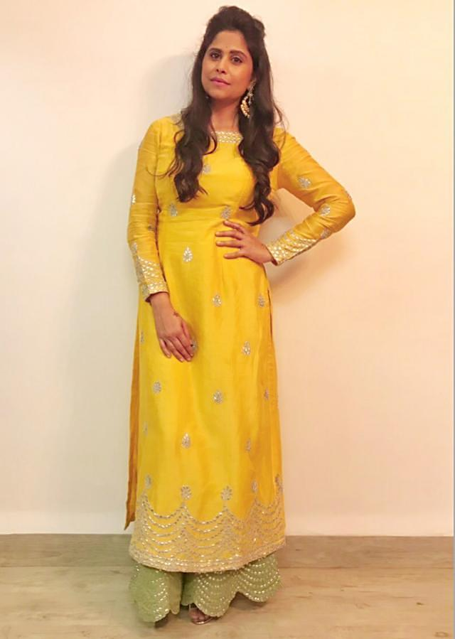 Sai Tamhankar in vibrant yellow and light green palazzo suit only on Kalki