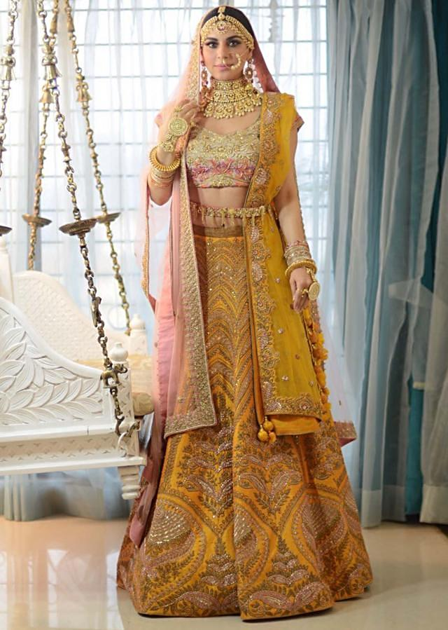 Shraddha Arya in Kalki chrome yellow lehenga and pink blouse beautified in zardosi embroidery work
