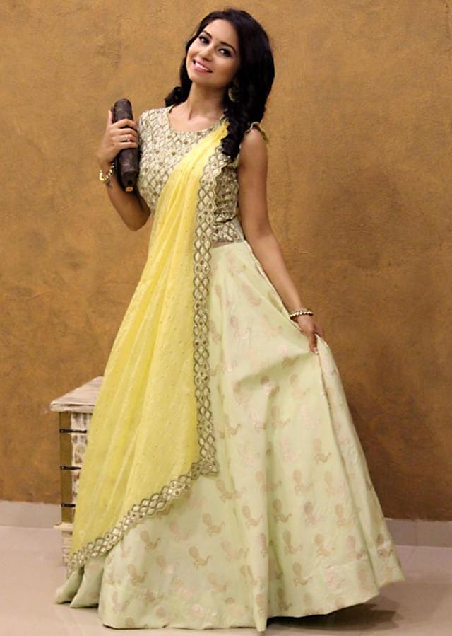 Vinny Arora in Kalki lime yellow suit with attach dupatta and embroidered bodice