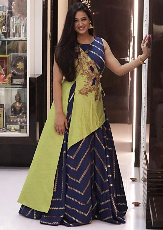 Double layered asymmetrical embroidery in pista green and blue gown only on Kalki