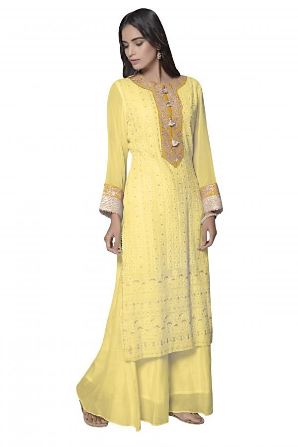 A line kurti in yellow lucknowi thread embroidery