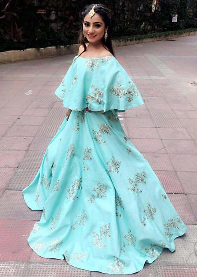 Aqua blue silk lehenga with a cape top embellished in zardosi and moti embroidery work only Kalki