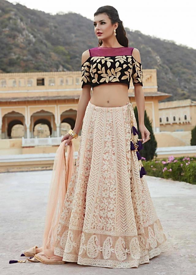 Cream lehenga in lucknowi embroidery matched with velvet blouse only on Kalki
