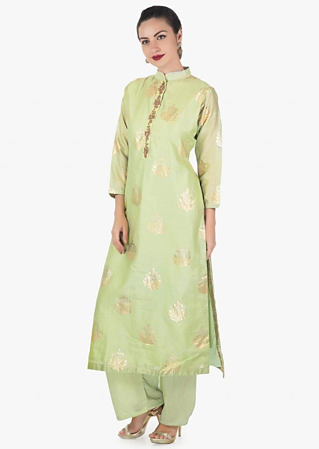 Pista green straight suit adorn in foil print and zardosi embroidered placket only on Kalki