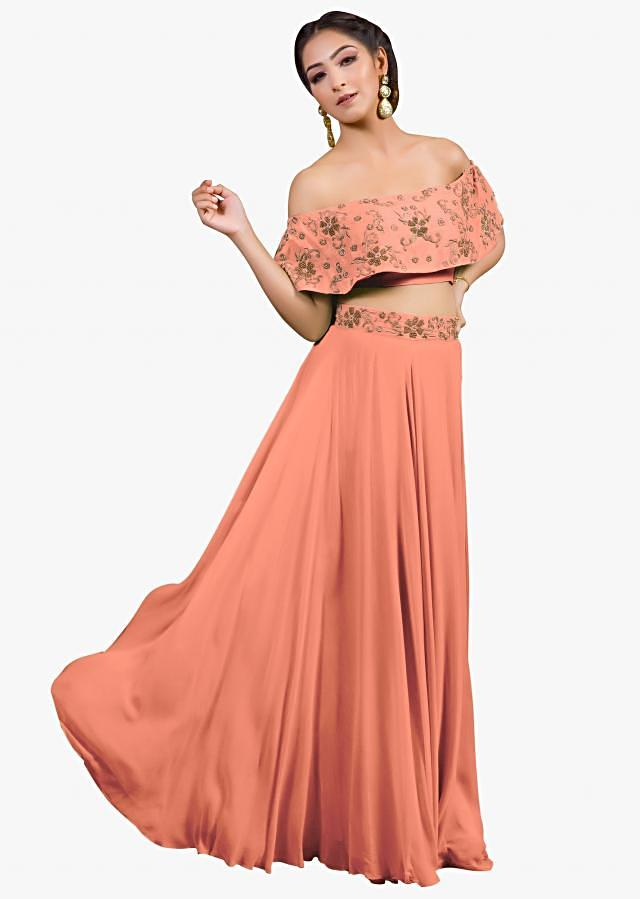 Peach lehenga matched with off shoulder embroidered cape only on Kalki