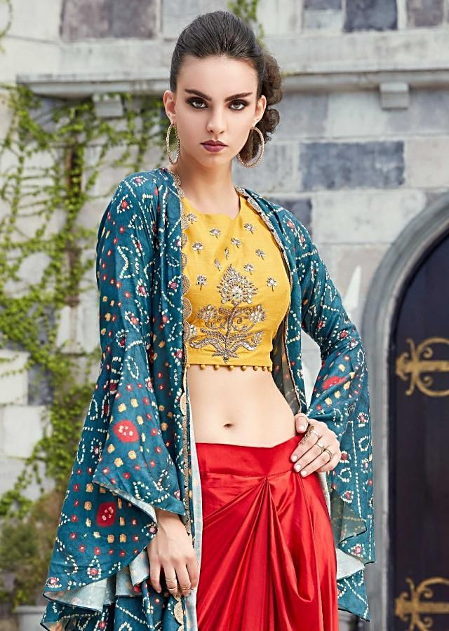 Yellow crop top embellished in mirror and zardosi matched with red fancy skirt and bandhni jacket