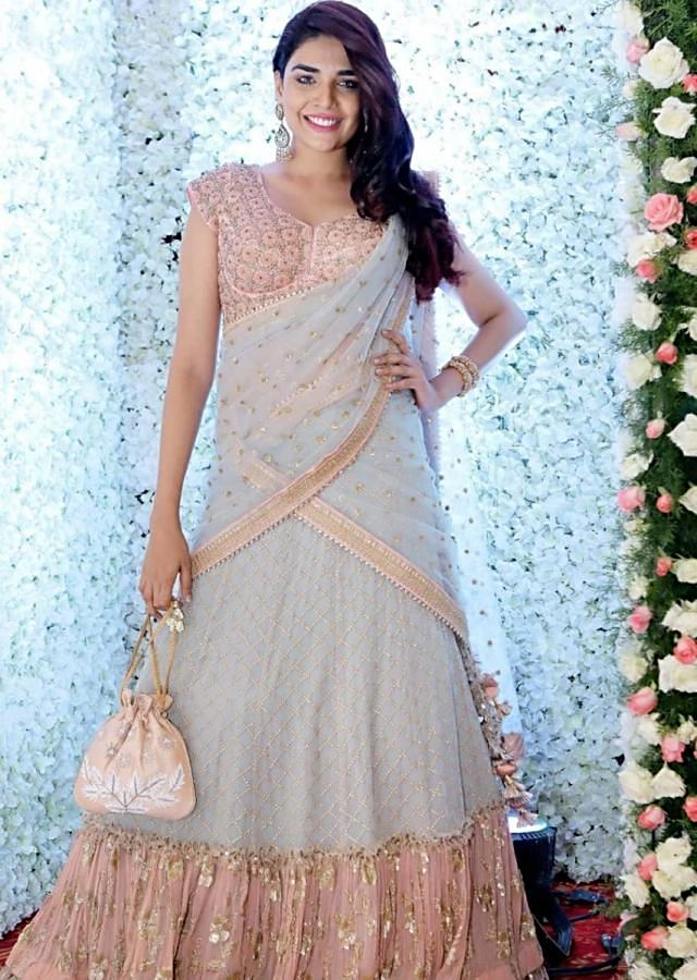 Anjum Fakih in Kalki powder blue embroidered lehenga with contrasting embroidered  peach blouse