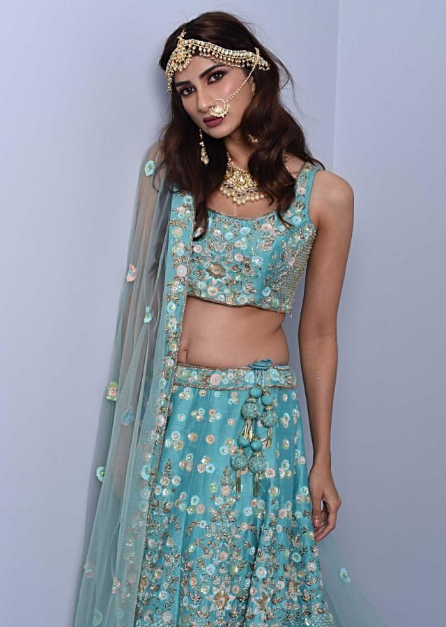 Sky blue lehenga set in heavy embroidered raw silk with floral and jaal motif Online - Kalki Fashion