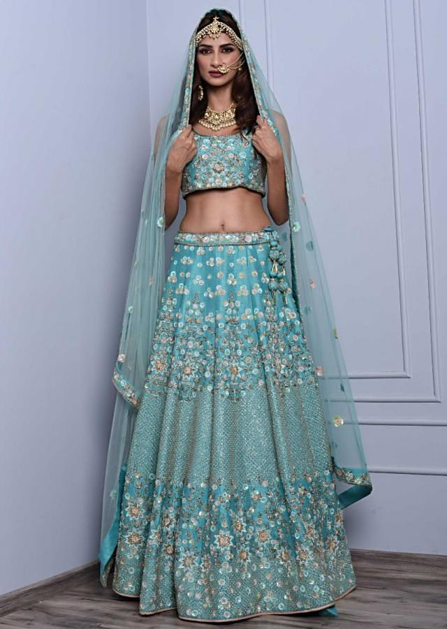 Sky blue heavy embroidered raw silk lehenga set in floral and jaal motif only on kalki