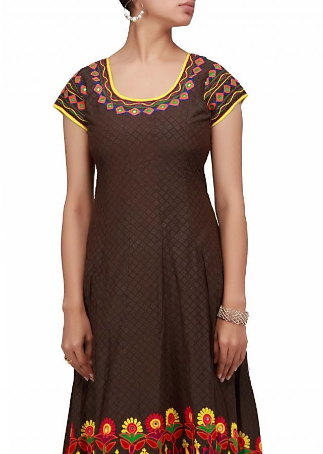 A brown anarkali dress with wool and mirror embroidery