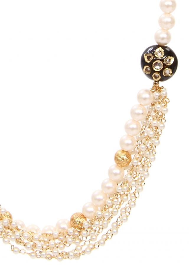 A tinch of brown with gold and white gives that elegant look only on Kalki