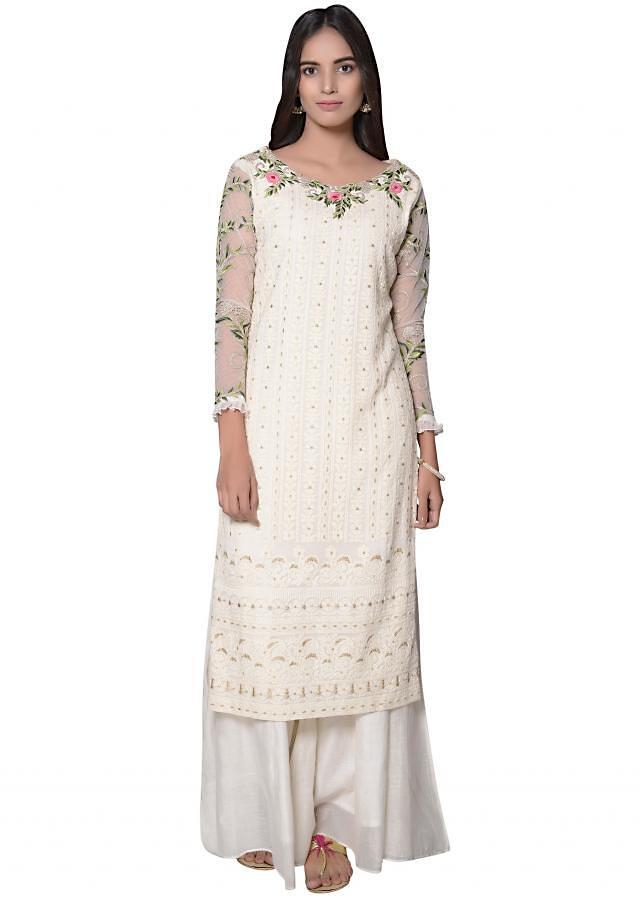 A line kurti in off white with resham and zari embroidered neckline