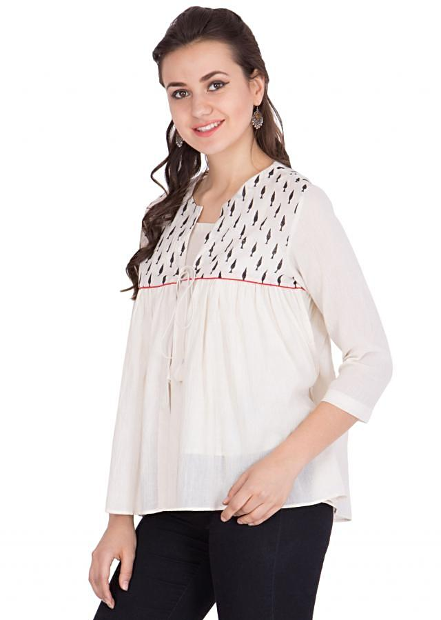 Add feminine style to your wardrobe with this sheer cotton top