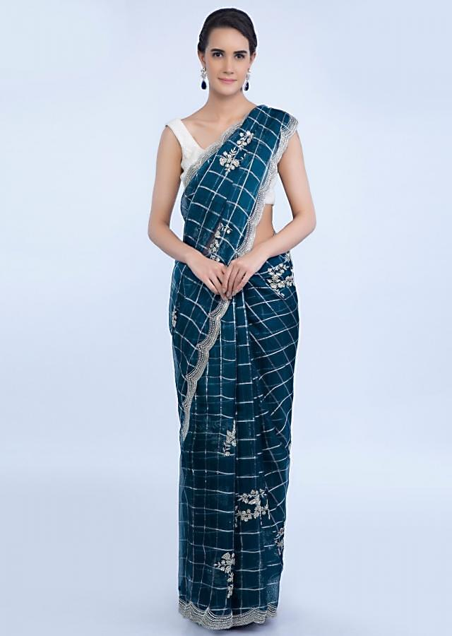 Aegean blue checks organza saree with embroidered butti only on Kalki