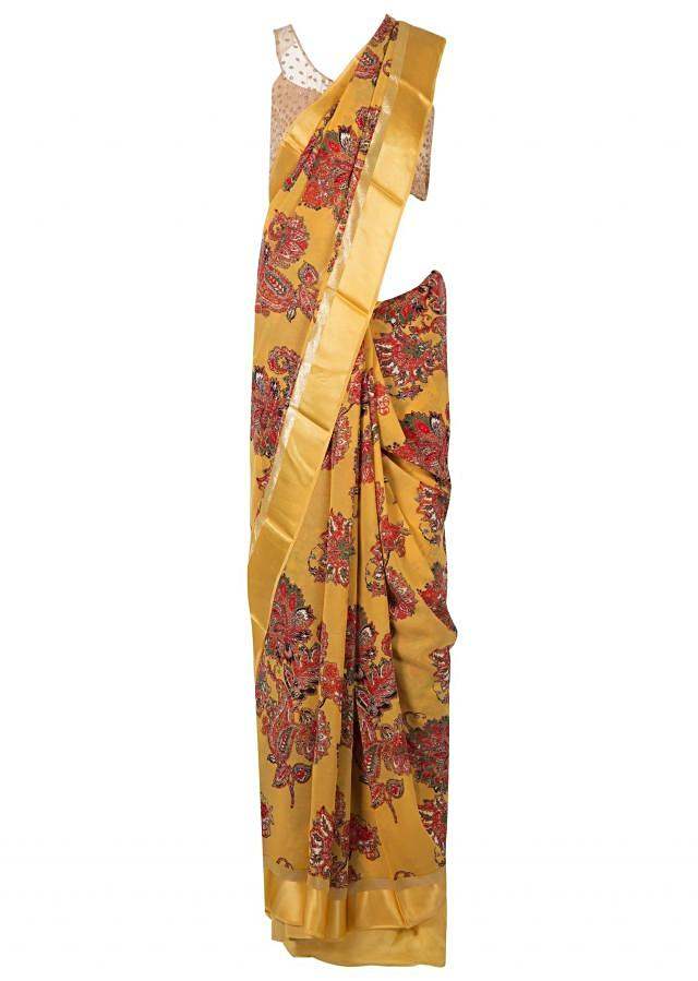 Amber yellow saree in satin with big floral print only on Kalki