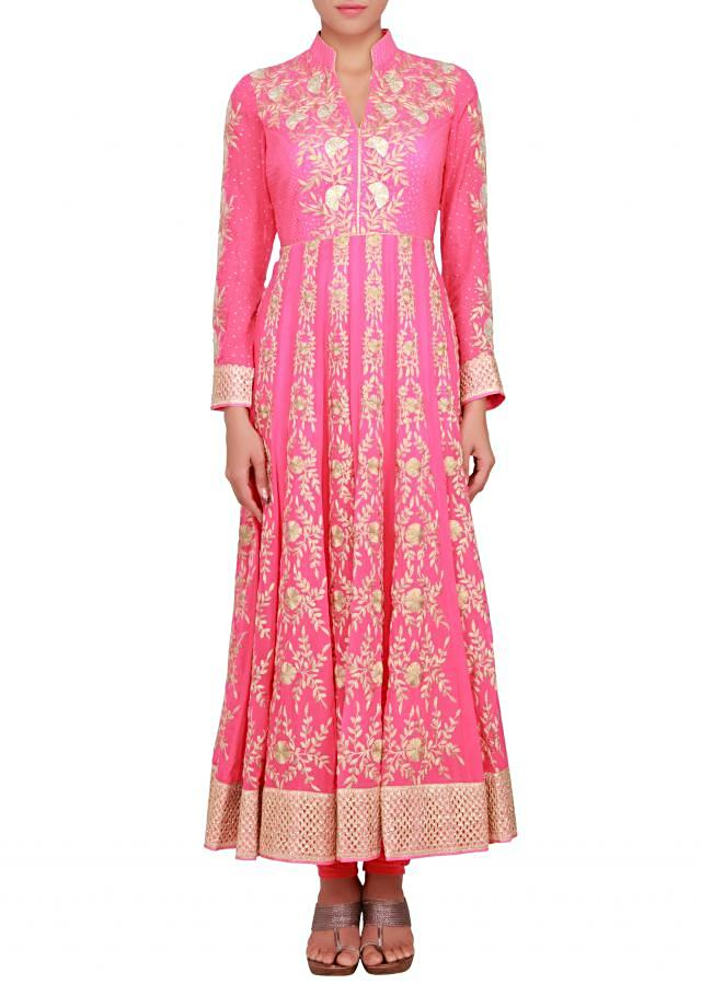 Anarkali suit in neon pink with embossed zari embroidery only on Kalki