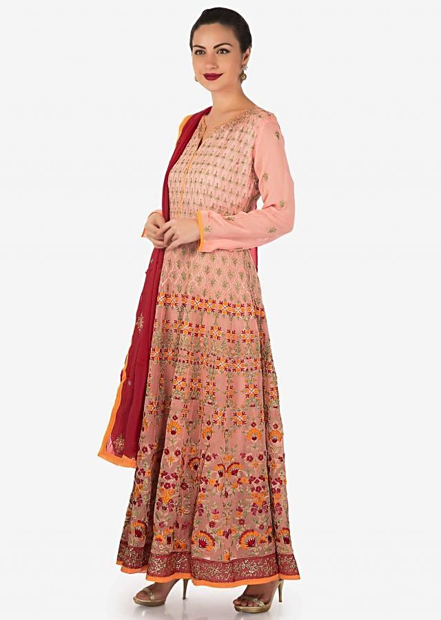 Anarkali suit in baby pink with resham and zari work in floral motif only on Kalki