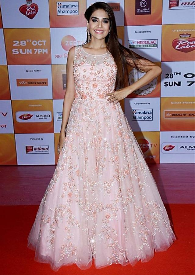 Anjum Fakih in Kalki peach embroidered net gown