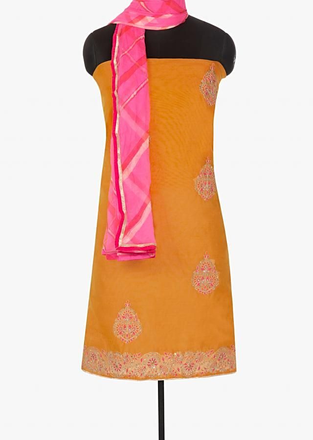 Apricot orange suit adorn in resham and sequin butti only on Kalki