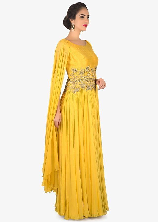 Apricot yellow anarkali suit with embroidered waist line only on Kalki