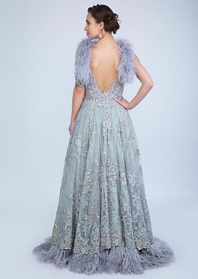 Aqua blue embroidered net gown with feathers at the strap and hem only on Kalki