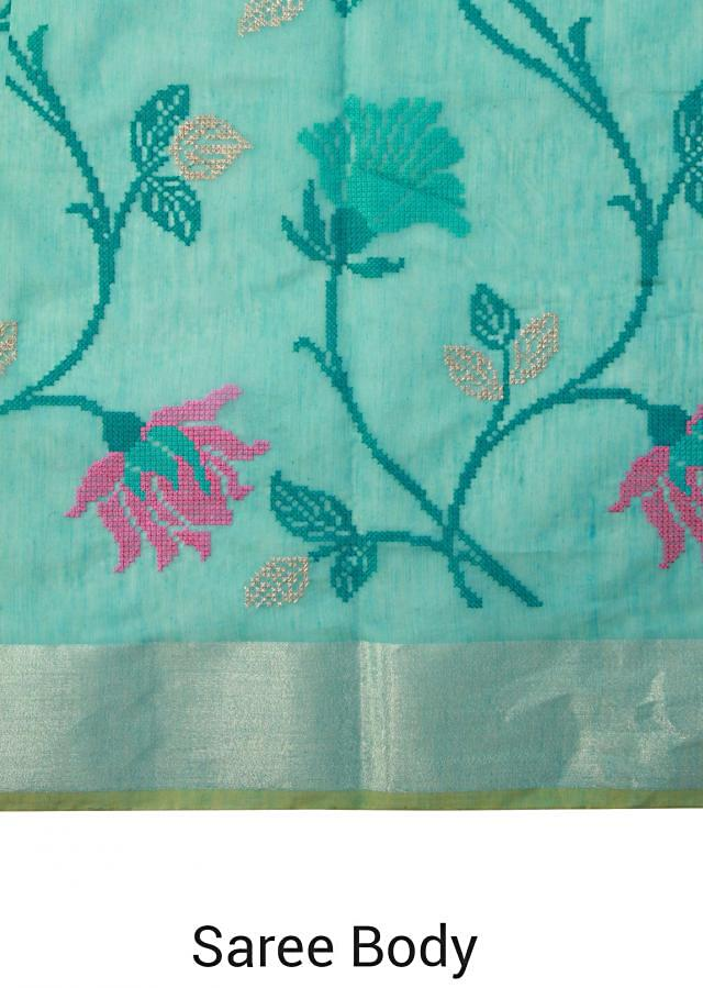 Aqua blue saree featuring with lotus motif embroidery only on Kalki