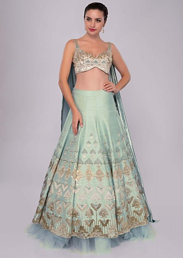 Aqua blue raw silk lehenga set with Greek inspired cowl drape at the back of the blouse only on Kalki
