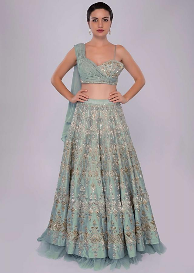 Aqua time blue raw silk lehenga teamed with one side strap bustier with georgette drape only on Kalki