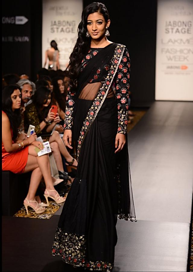 Model walks the ramp in beige and black anarkali suit with embroidered bodice for Arpita Mehta