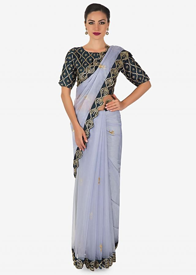 Ash blue saree  in organza with sequin and cut dana work design exclusively on kalki