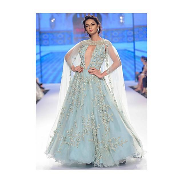 Aviary blue  flared net gown with double circular pattern and  net trail only on Kalki