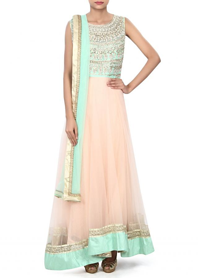 Baby pink and green anarkali suit adorn in zardosi embroidery only on Kalki