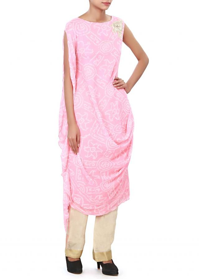 Baby pink bandhani suit enhanced in cowl drape only on Kalki
