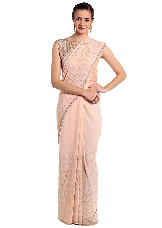 Baby pink chiffon saree embellished with kundan work only on Kalki