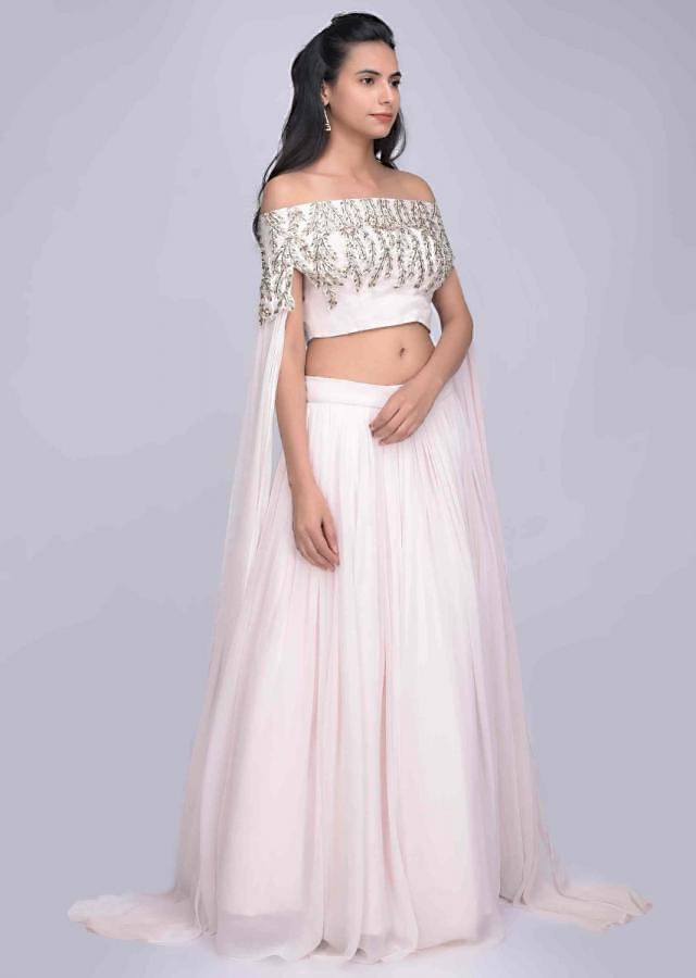 Baby pink georgette skirt with fancy cape sleeved crop top set only on Kalki