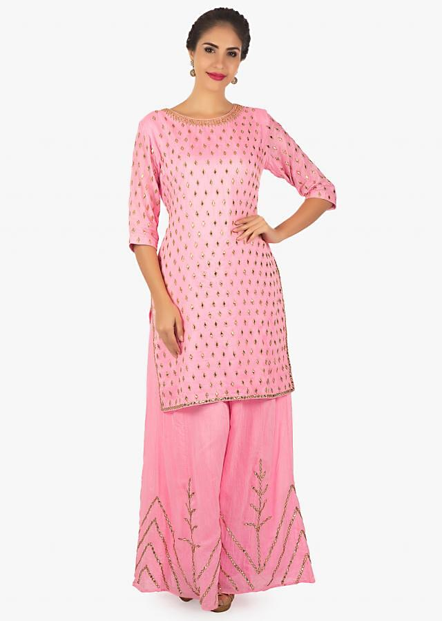 Baby pink kurti palazzo embellished with gotta patch work all over only on Kalki