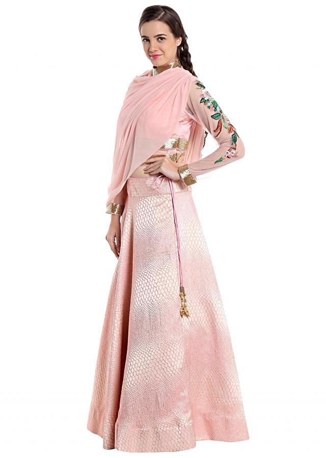 Baby pink lehenga features with fanct cape only on Kalki