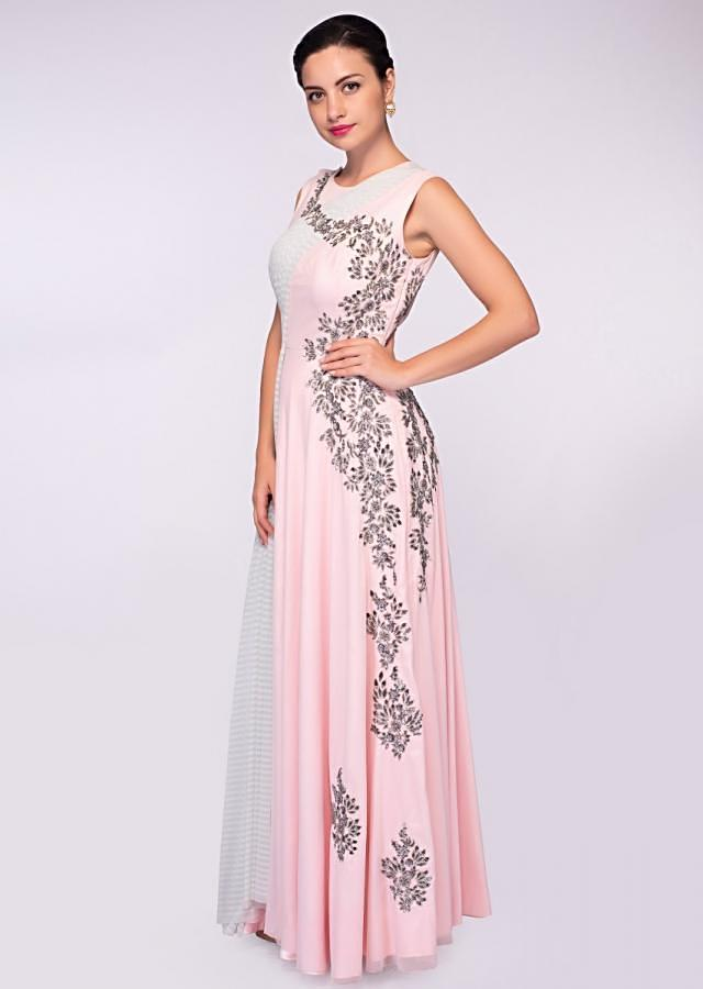 Baby pink lycra net gown with one side embroidery and one side drape only on Kalki