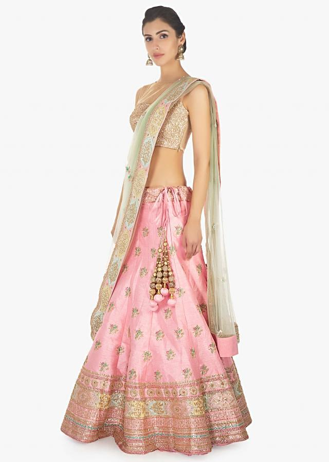 Baby Pink Lehenga Choli In Raw Silk Paired With A Contrasting Green Net Dupatta Online - Kalki Fashion